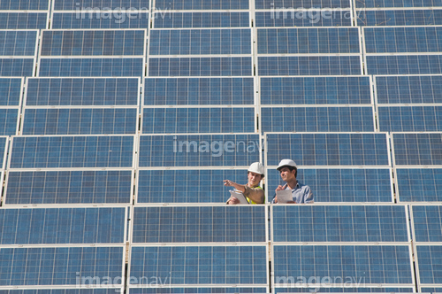 two engineers in solar power plant