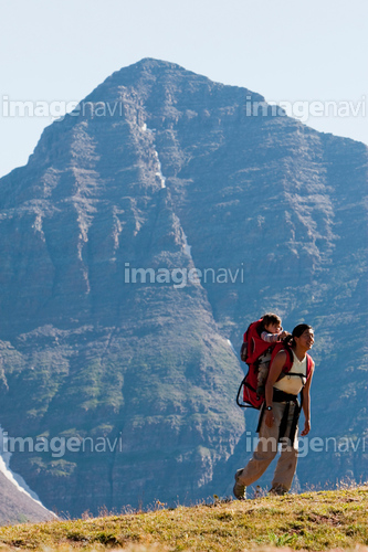 A mother carries her 14 month old son in her backpack over Frigid Air Pass during a multiday backpacking trip in the Maroon Bells in Snowmass Wilderness between Crested Butte and Aspen, Colorado.