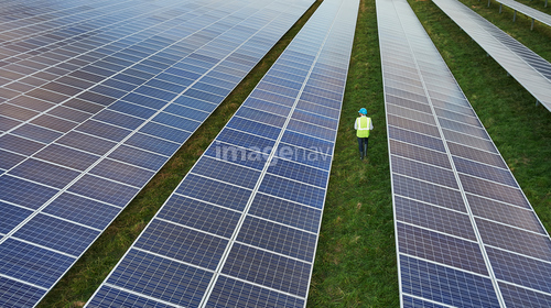Male Engineer in safety clothing on solar farm