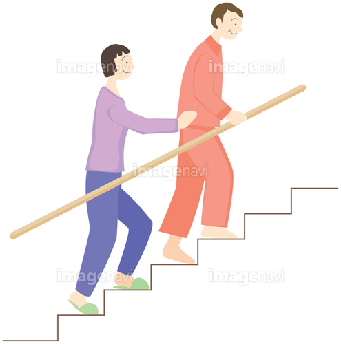 階段を上る高齢者と介護者】の画...