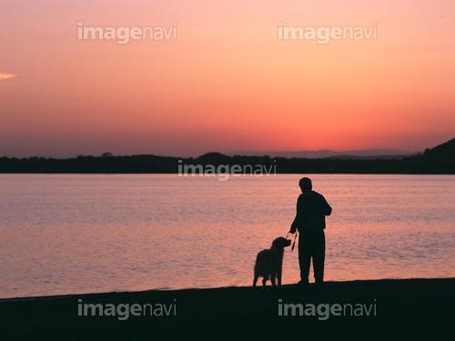 達古武湖 犬と男性