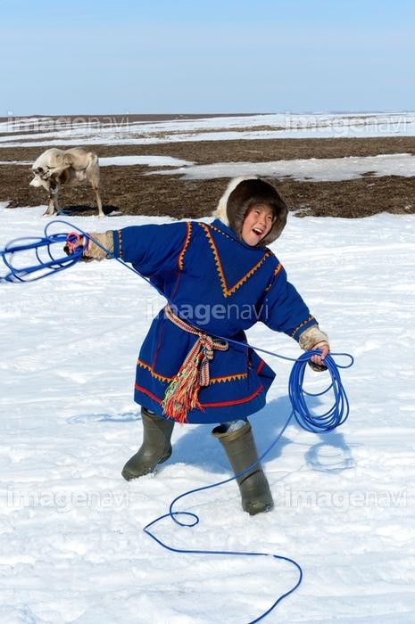 【イメージナビ】A nenets herder boy practising with his lasso and wearing the  traditional